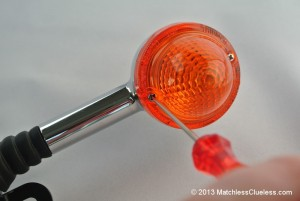 Unscrewing the orange plastic indicator lens